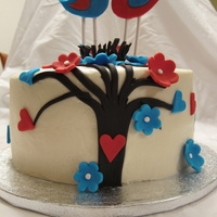 Lovebird Cake Lovebird theme cake, blue and red were the wedding colors. Cake was red velvet too.