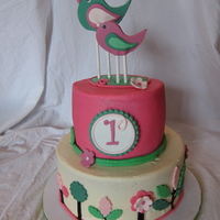 Bird Birthday Cake Little girl's first birthday with the pink and green garden theme.