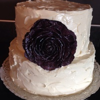 072714 Eggplant Colour Flower On White Chocolate Cream Cheese Icing Messy Look 07/27/14 Eggplant colour flower on white chocolate cream cheese icing, messy look.