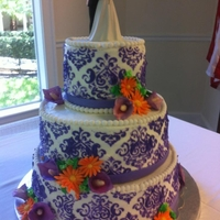 Damask Design Wedding Cake Top and Bottom Tiers are Chocolate cake with chocolate ganache filling. Middle tier is Red Velvet with Mascarpone/Whipped Cream filling....