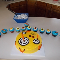 Nerf Cake Death by Chocolate Cake with Chocolate Mousse filling and butter cream frosting. Decorations made with Fondant.