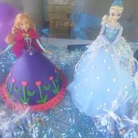 Frozen Theme Party For my grand daughters 5th birthday. Vanilla bean white cake and one strawberry with butter cream icing and fondant,awnd the edible was a...