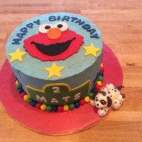 Elmo Birthday Cake 8 in WASC with buttercream. All details in fondant.Fondant puppy - which was something the birthday boy wanted.