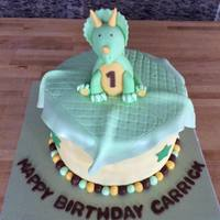 Triceratops Cake 8 in WASC with banana cream pie filling. Fondant triceratops and fondant blanket.