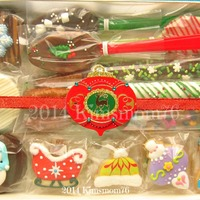 Mini Christmas Cookies  Mini cookies I added to decorated chocolate covered oreos, pretzels, and spoons. I was able to fit a double row of minis in this one pound...