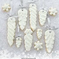 Icicle Cookies   Wanted to update my old icicle cookies. NFSC with RI. The snowflakes have fondant accents. Thanks for looking.