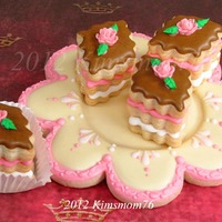 Edible Plate And Petit Four Cookies   NFSC and royal icing with fondant roses. These were part of a birthday cookie exchange for Dawn (Kneadacookie). Thanks for looking.