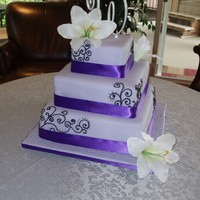 Lavender Wedding Cake Traditional Caribbean Black cake (fruit cake) made with lots of rum and port wine. Covered with marzipan and fondant. Scrolls done with...