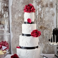 White Lace Cake With Black Ribbon And Deep Red Roses White lace cake with black ribbon and deep red roses,