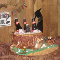 "Groom's Cake. Cake is Chocolate. Iced in Buttercream and is sitting on a ""slice"" of wood. The beer bottles are real (empty) as are the animals..."