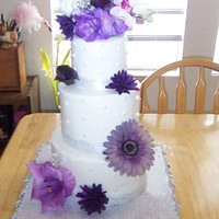 Wedding 11/11/11 8, 6 and 4 in. tiers. Wedding colors are purple and silver.