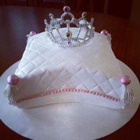 Rylee's Birthday Cake White cake with buttercream filling. This was my first attempt at a pillow cake. I was planning on making the tiara out of royal icing but...