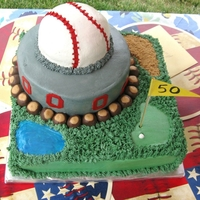 Sports Fan My husband's 50th birthday cake. His three favorites are featured in the cake. Golf, Ohio State Football and Baseball. Buckeyes for...
