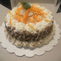 Gourmet Carrot Cake Carrot Cake with Fresh Mint and Candied Carrot Curls and Candied Mint leaves.