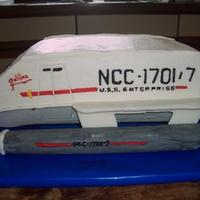 Galileo Shuttlecraft I made this cake for my husband and a friend whose birthdays are only a week apart. Yellow cake frosted and decorated in buttercream. The...
