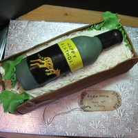 Wine Bottle In Crate Wine bottle in crate. Bottle is fondant shell filled with cake. Crate is double layer 6.5 x 15 inch chocolate cake. crate walls are fondant...
