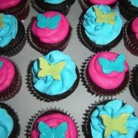 Butterfly Cupcakes Red velvet and fudge chocolate cupcakes with buttercream, fondant butterflies and sprinkled with disco dust.Made for end of the year ballet...