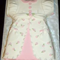Baby Dress vanilla cake with lots of fondant accents! love doing these baby dresses
