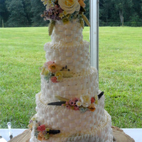 Basket Weave Wedding Cake 4, 6, 8, 10, 12 basket weave wedding cake with gumpaste flowers. This cake was a near disaster. It was pouring rain we were under a tent...