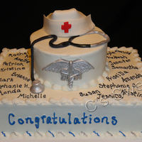 Nurse Graduation With Stethoscope, Nurse Cap And Rn Emblem Marble cake with Strawberry BC filling, and Dark chocolate cake with Fudge BC filling. Nurse hat, stethoscope and RN emblem are made from...