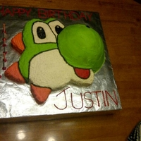 Yoshi Birthday Cake This Yoshi is all chocolate cake with whipped vanilla icing...unfortunately, I had a little trouble with the whipped icing melting so it...