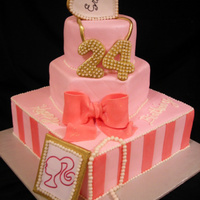 24 This cake is a combination of cakes that the customer found on Gimme Me Some Sugar Cakes (Las Vegas) website!! She wanted Barbie...