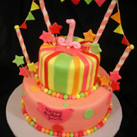 "Carnival 1St Birthday This cake is a combination of cakes that the mother of the birthday girl found. These are the colors she chose. 6"" & 10""..."