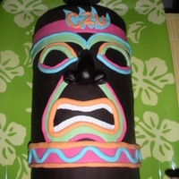 Tiki Cake  Made this cake for my hubby's going away Luau. Got the idea from several cakes I seen here on the site. Thanks to those, so sorry i...