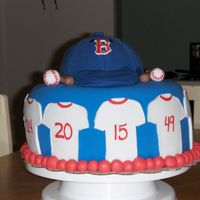 Red Sox   my first hat! had some trouble with the fondant acting funny but I'm happy with the result considering my experience :)