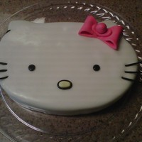 Hello Kitty   this is a fondant cake that I made for a friend wiskers are made with spaghetti and fondant