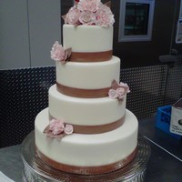 Wedding Cake   this cake was created using brown ribbon and matching flowers