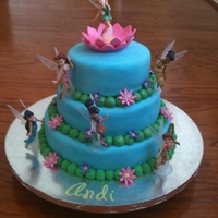 Tinkerbell   3-tiers decorated with fondant, gumpaste, & luster dust.