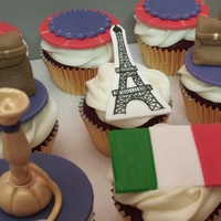 Travel To Spain And India Red velvet cupcakes with cream cheese icingEiffel Towers, Hookah, Spain Flag, Luggage