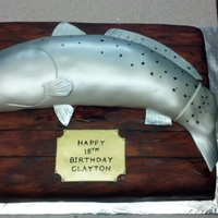 Big Catch Trout make out of rice crispy and covered in buttercream and fondant. Americolor Silver Airbrush, painted spots.Wood airbrushed and hand...