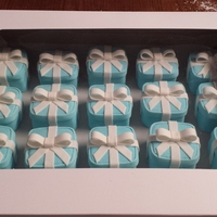 Tiffany Boxes   Square pound cakes with blue satin ice fondant and white fondant bows