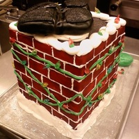 "Santa Going Down The Chimney Chimney cake 10"" squares. covered in fondant bricks, filled in with royal icing. blown sugar bulbs."