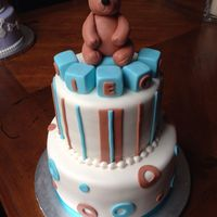 "Baby Bear Shower Cake 9"" and 6"" cakes covered w/ marshmallow fondant, decorations are all fondant, bear is fondant also."