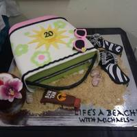 Employment Anniversary Cake *Made this for a co workers 20th anniversary with the company. She loves vacationing in Mexico on the beach. Bag is cake covered in fondant...