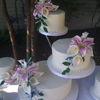 Butter Cream Cake With Sugar Stargazer Lilies, Calla Lilies And Stephanotis With Ladybugs This was for a very casual lakeside wedding and BBQ. They wanted something very simple with the flowers being the showpiece. Loved making...