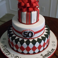 Horse Racing Silks Inspired 50Th Birthday Cake This was for a gentleman's 50th birthday party. He is a big horse racing fan and his wife surprised him with this cake. She wanted...