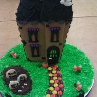 Wilton Haunted Mansion Made this for a display for my class. Fun kit to make and personalize and a great bargain. Added the graveyard with mini milano cookie...