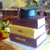 Graduation Cake-Books And Grad Cap Sharon Zambito-you ROCK! The dvd really helped so much. This is one of those anything that can go wrong did cakes. My first book cake, and...