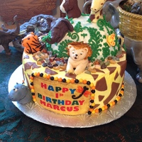 Jungle Theme Birthday Cake fondant jungle animals on 2 tier buttercream covered cake