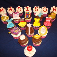 Disney Inspired... Cupcakes for a birthday girl with a disney princesses theme! All handmade toppers from mmf. TFL