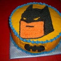 Batman Cake   Choc Cake- two layers filled with choc ganache.covered with MMF. Deco is Naked Buttercream