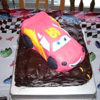 Lightening Mcqueen Lightening is made of rice crispie treat formed into the shape, and covered in fondant, sitting on chocolate cake with whipped ganache...