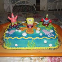 Spongebob Squarepants   Marble cake with buttercream and royal icing. Spongebob figurines bought at Walmart.