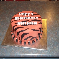 Wests Tigers Cake I made this Wests TIgers cake a few weeks ago. It's a vanilla sponge with vanilla butter cream and a little jam.I rolled the stripes...