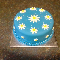 "Daisy Cake I looked at a lot of daisy cake pictures and came up with this. It was for my cousin. She loved it.I enjoyed making it.Its an 8""..."