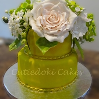 Egg-Less Carob Cake With Carob Ganache Frosting, Filling, Andpistachio Cream Filling (^_^) Carob Cake w/ Carob Ganache and Pistachio Cream Filling. All the flowers are made w/ sugarpaste = 50/50 fondant and gumpaste.